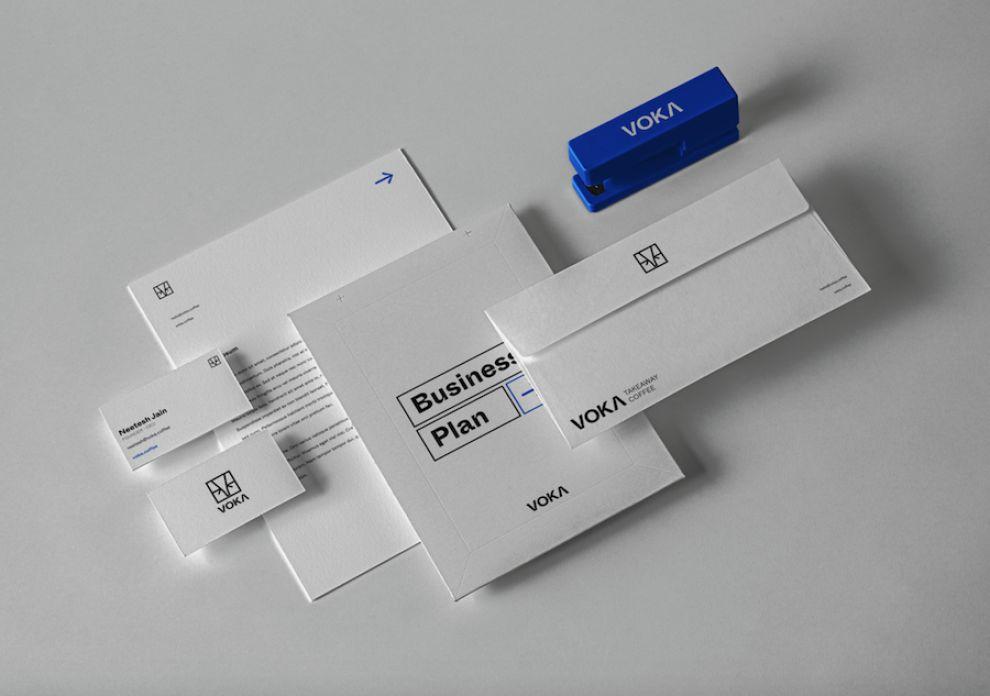 Voka logo design on different branding materials.