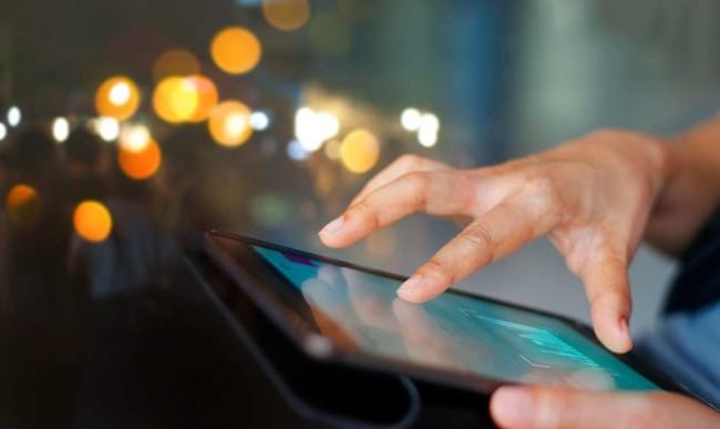 A man using an app on tablet