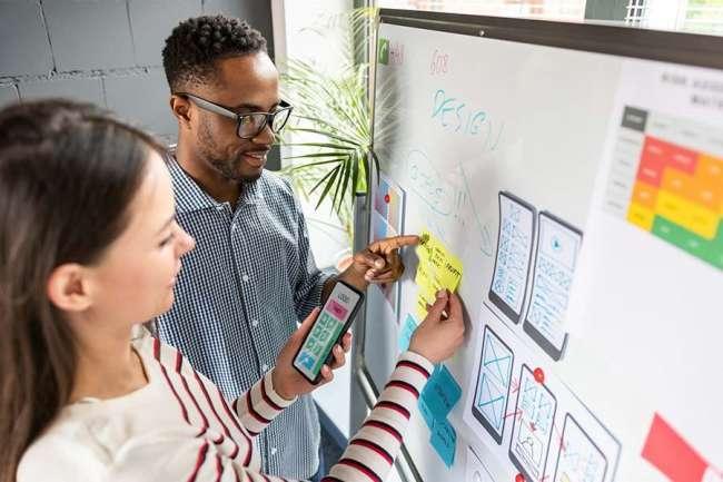 Marketing team members going through campaign design plan