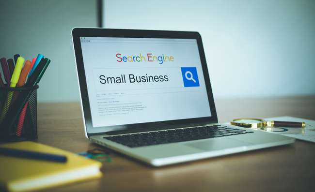 A laptop on a desk with a small business SEO display picture