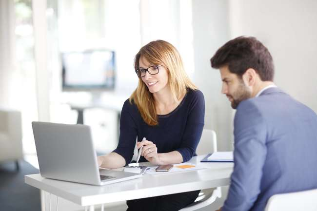 An SEO consultant talking with a client