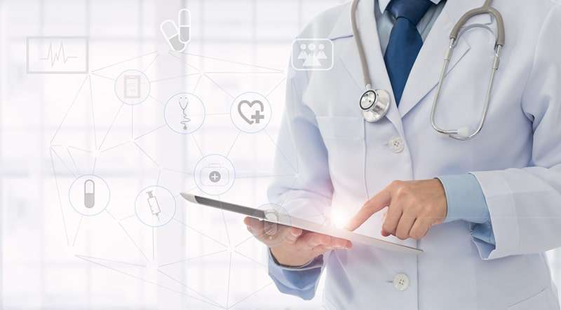 A doctor using healthcare software created by the top healthcare software development companies