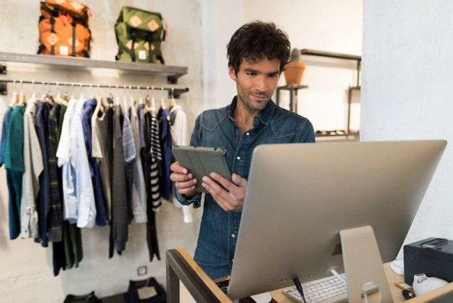 A businessman using free inventory management software
