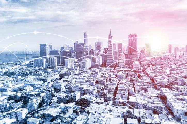 Web development companies in USA: San Francisco skyline with digital data and communication network