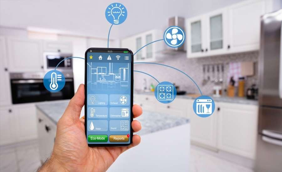 Hand holding mobile device with smart home control and icons.