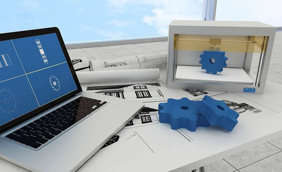 Top product design companies: Office desk with laptop, 3D printing gear and design materials