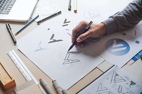 Logo designers creating a logo for a client