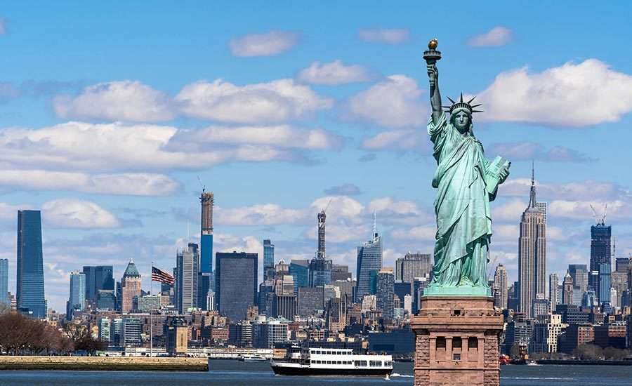 NYC creative agencies: the statue of liberty with New York cityscape in the background