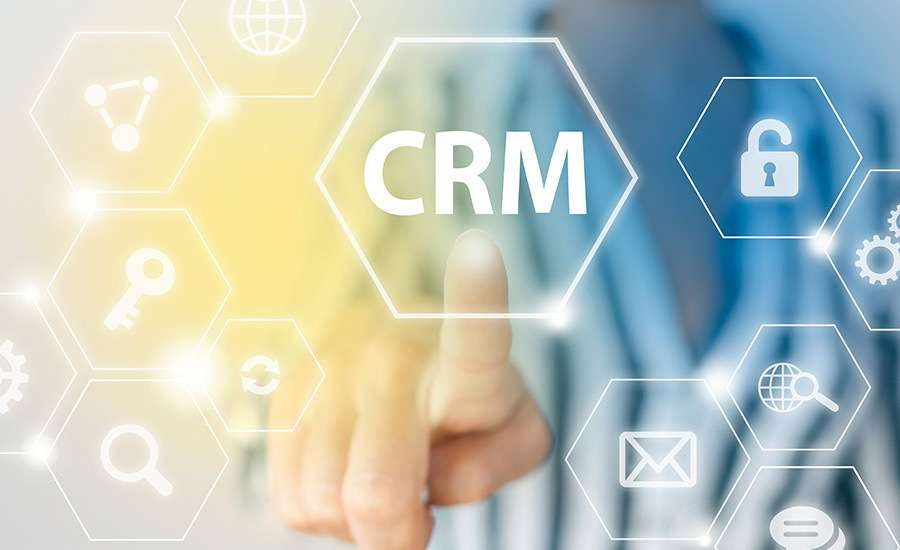 consultant touching a screen with CRM icons